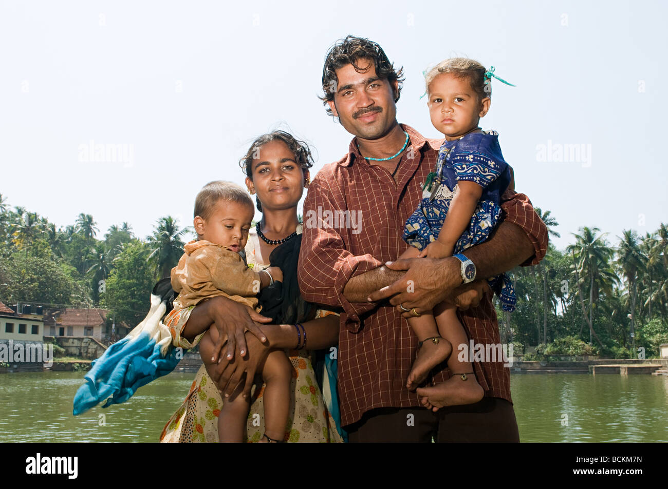 Indian family by communal baths - Stock Image