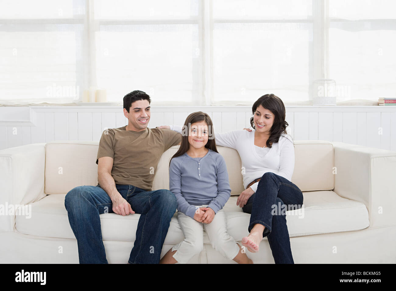 Hispanic parents with daughter - Stock Image