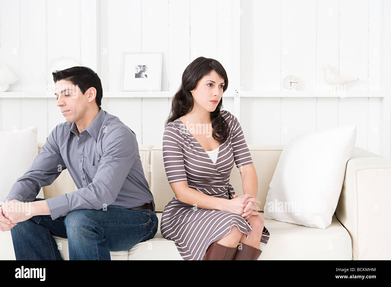 Hostile couple in a living room Stock Photo