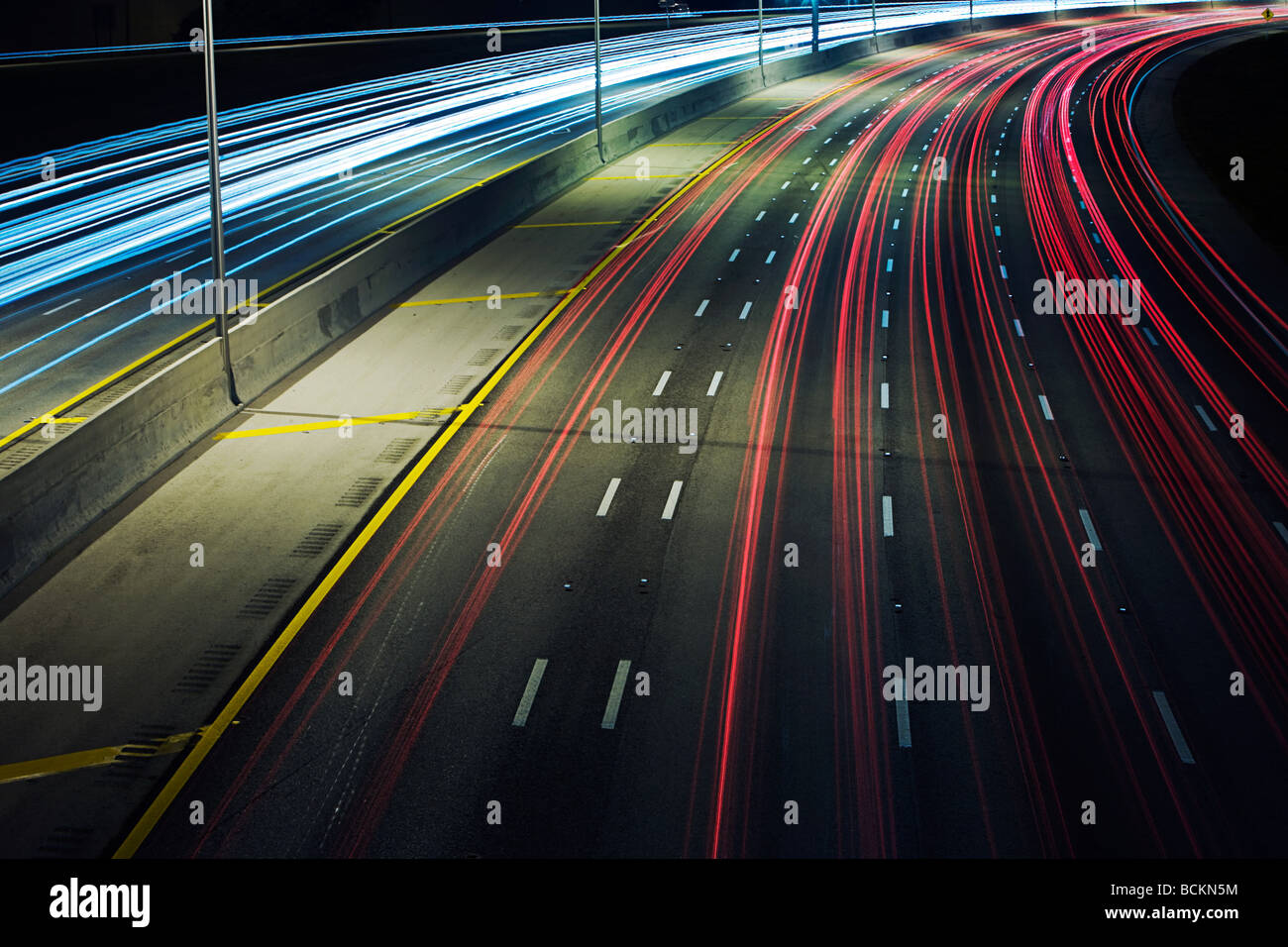 Automobile lights on highway - Stock Image