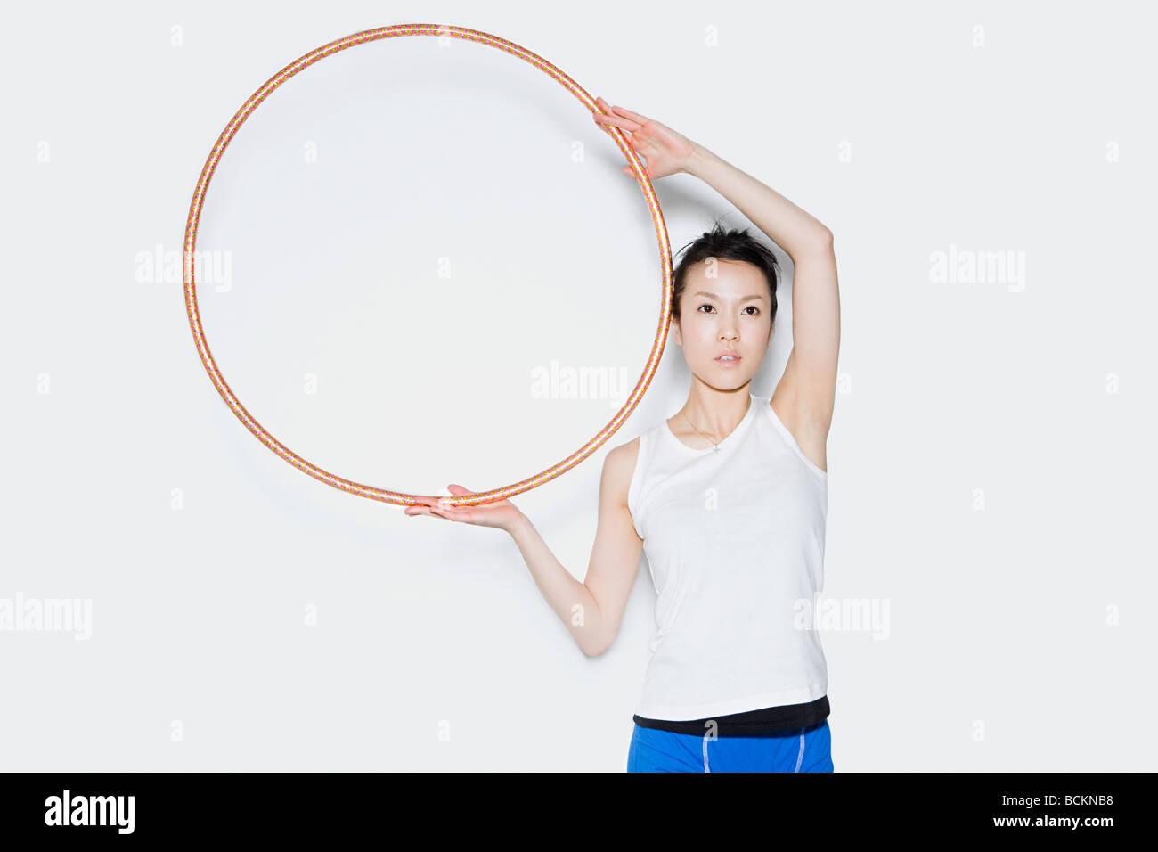Woman holding hoop Stock Photo