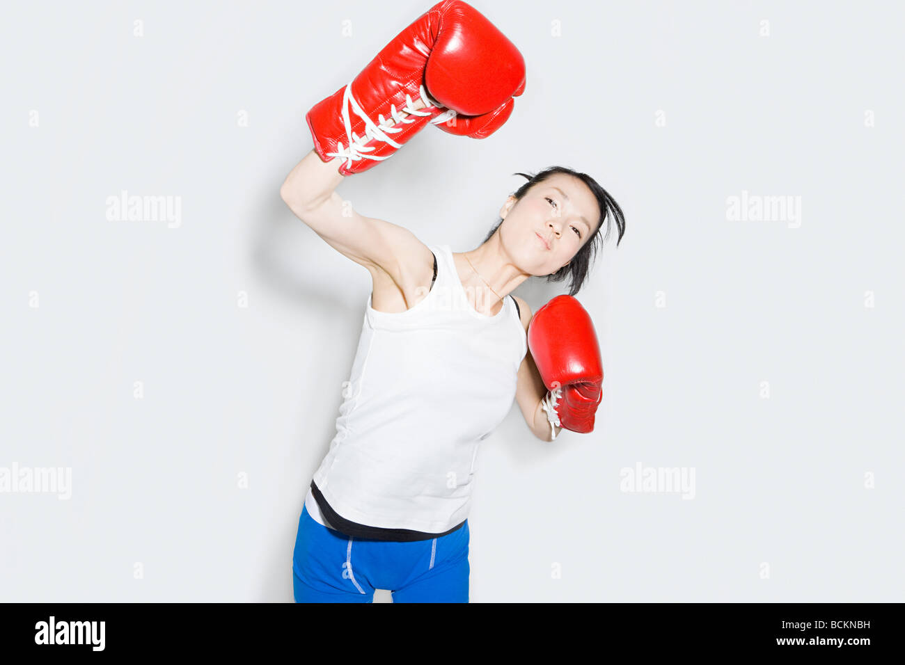 Young woman in boxing gloves - Stock Image