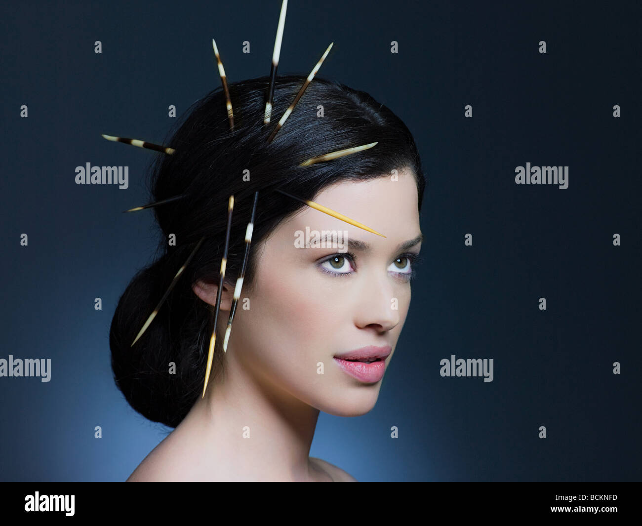 Young woman with porcupine quills in hair Stock Photo