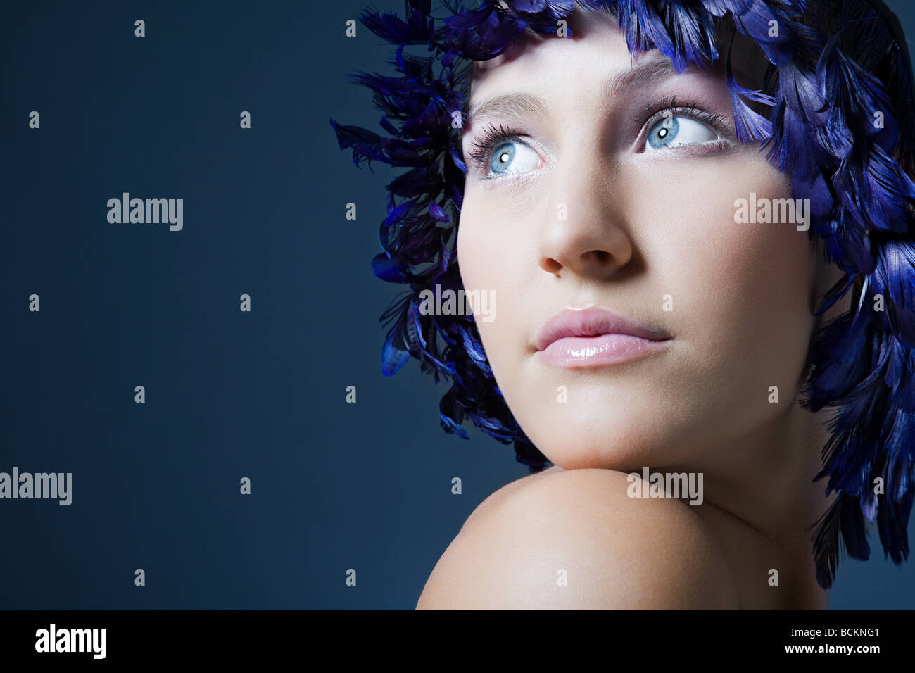Girl with feather headdress - Stock Image