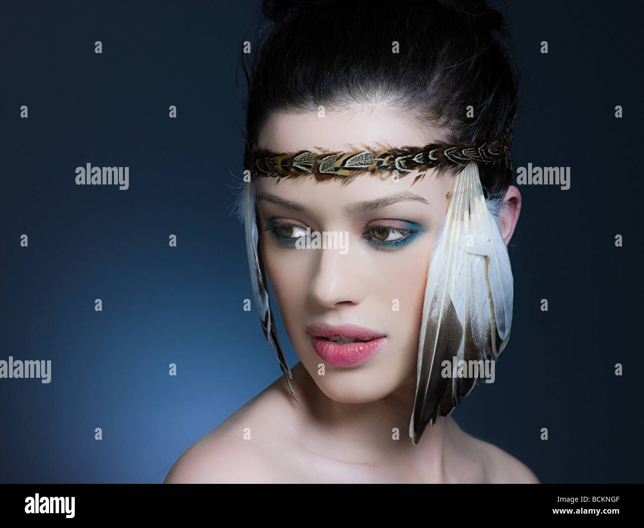 Young woman with feather headdress - Stock Image