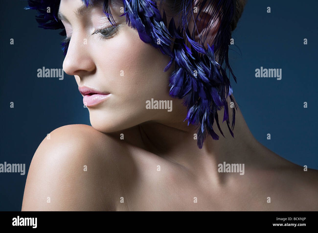 Girl with feather headdress Stock Photo
