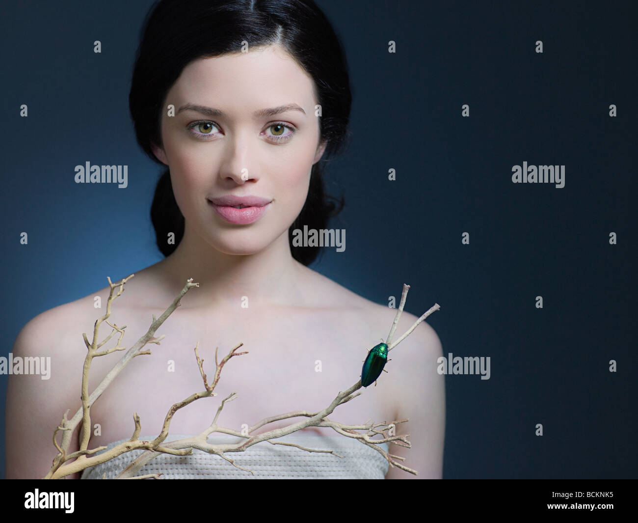 Young woman with a branch - Stock Image
