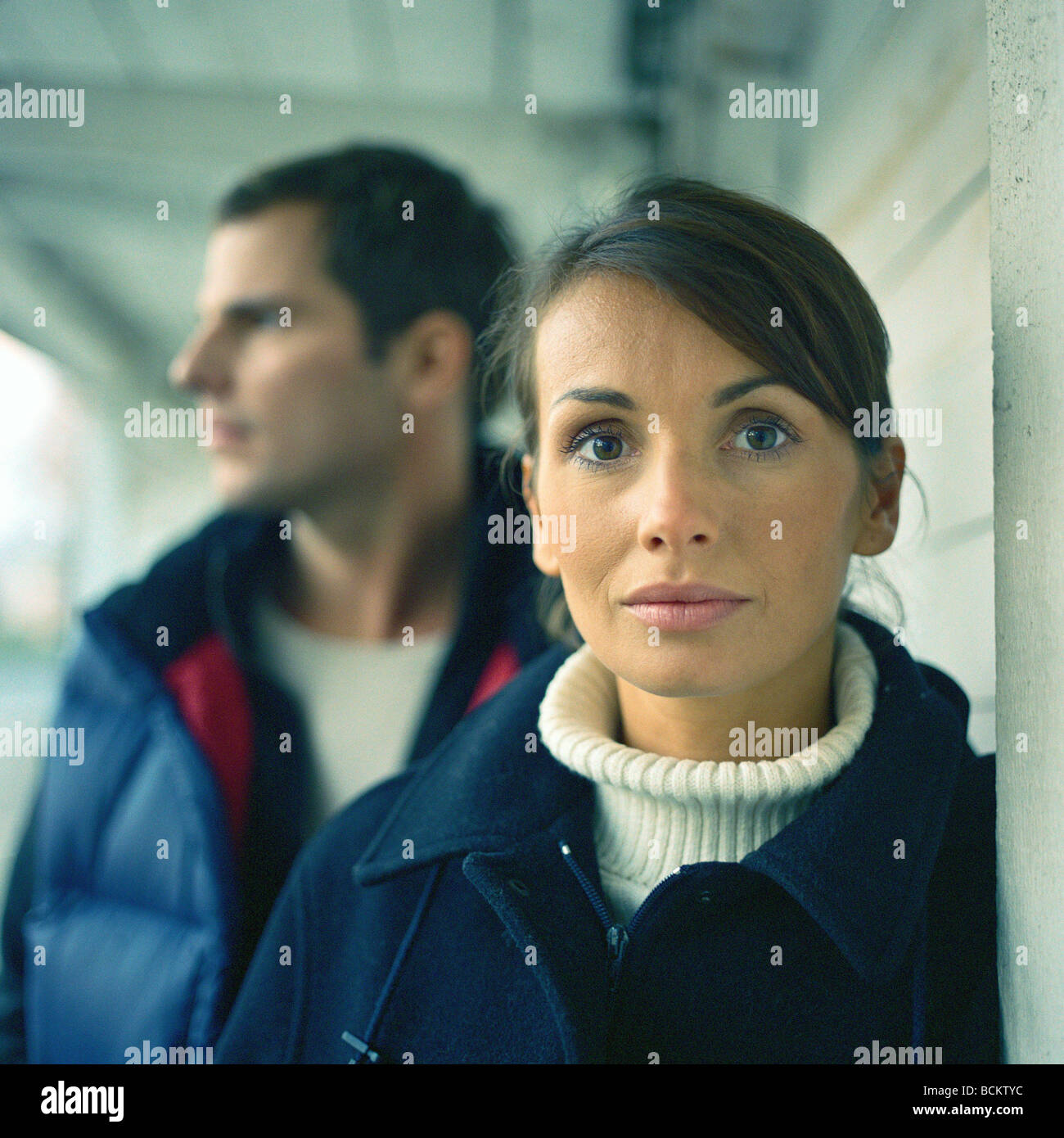 Man and woman standing together in covered walkway - Stock Image