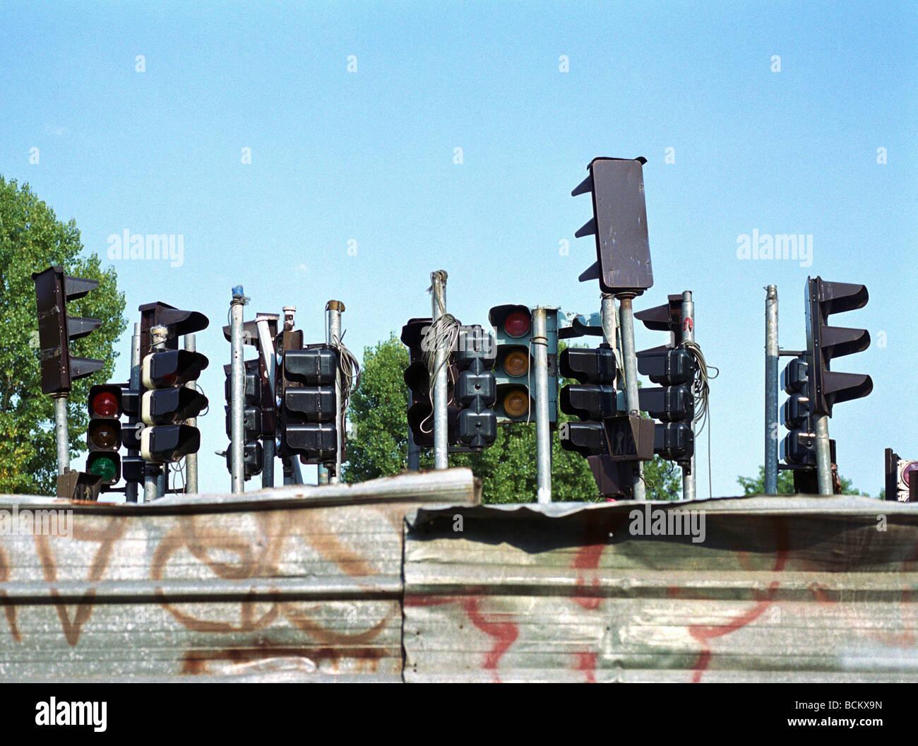 Group of stoplights behind metal enclosure - Stock Image