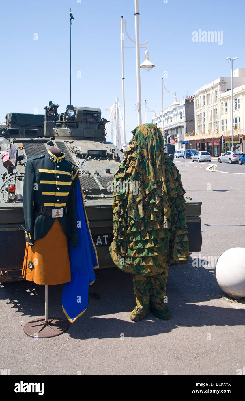 Exhibition of Dress uniform and camouflage outfit from Princess of Wales's Regiment. Worthing, West Sussex, - Stock Image
