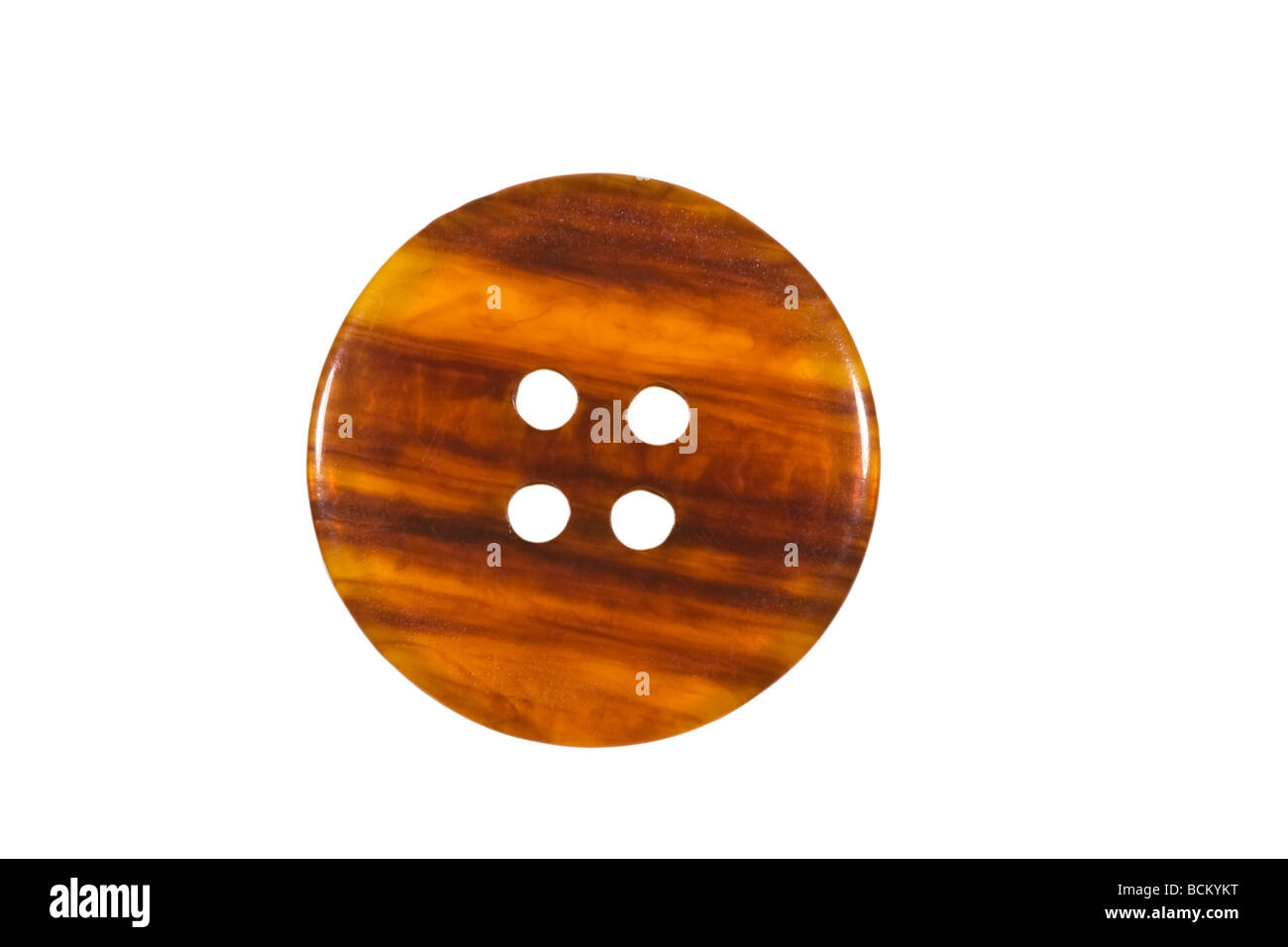 Orange brown wood coloured button - Stock Image