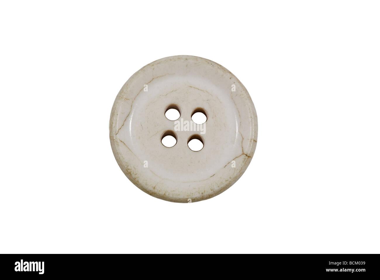 Crazed white coloured button - Stock Image