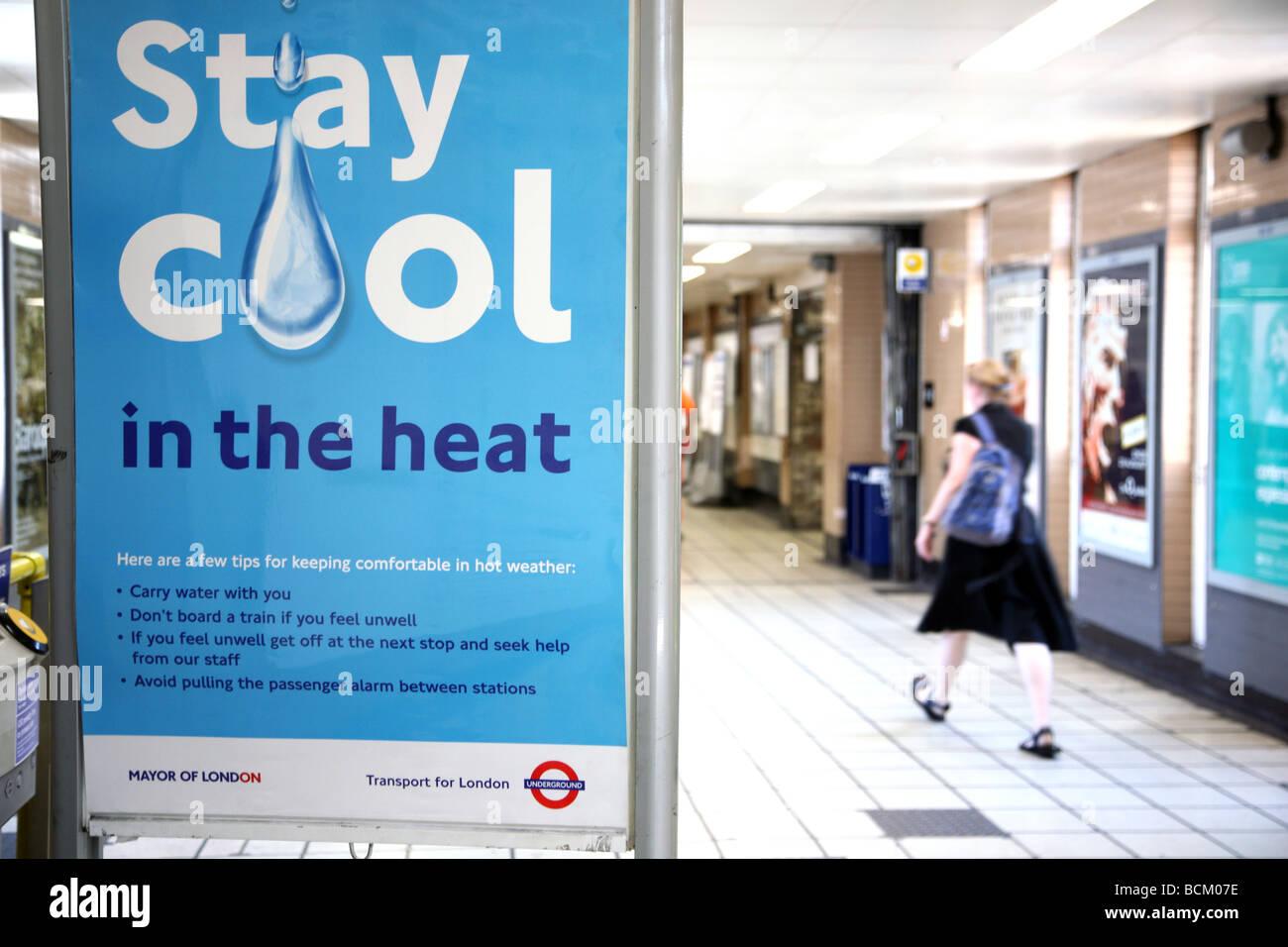Hot weather advice in London Underground station - Stock Image