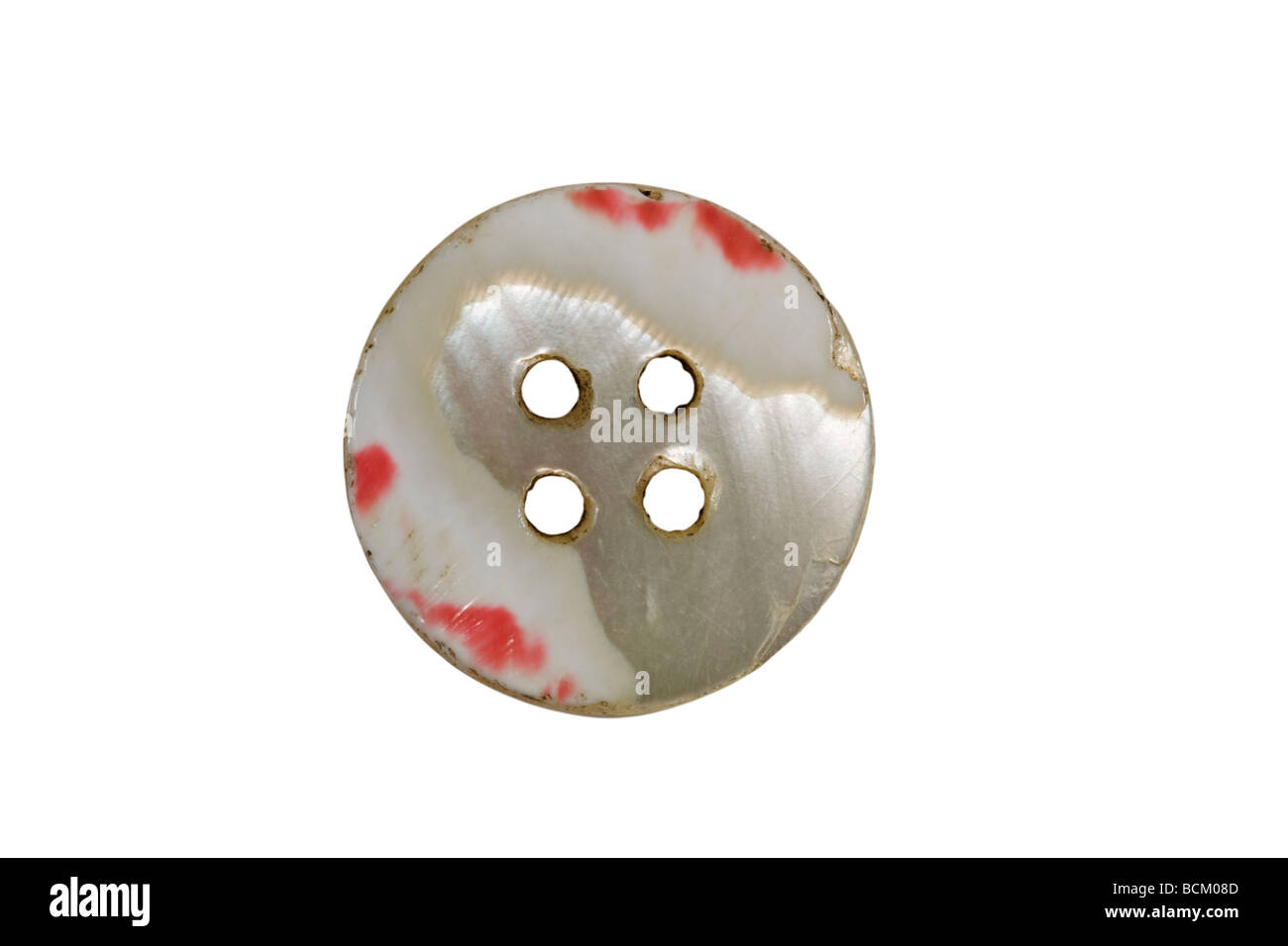 Red and white coloured button - Stock Image