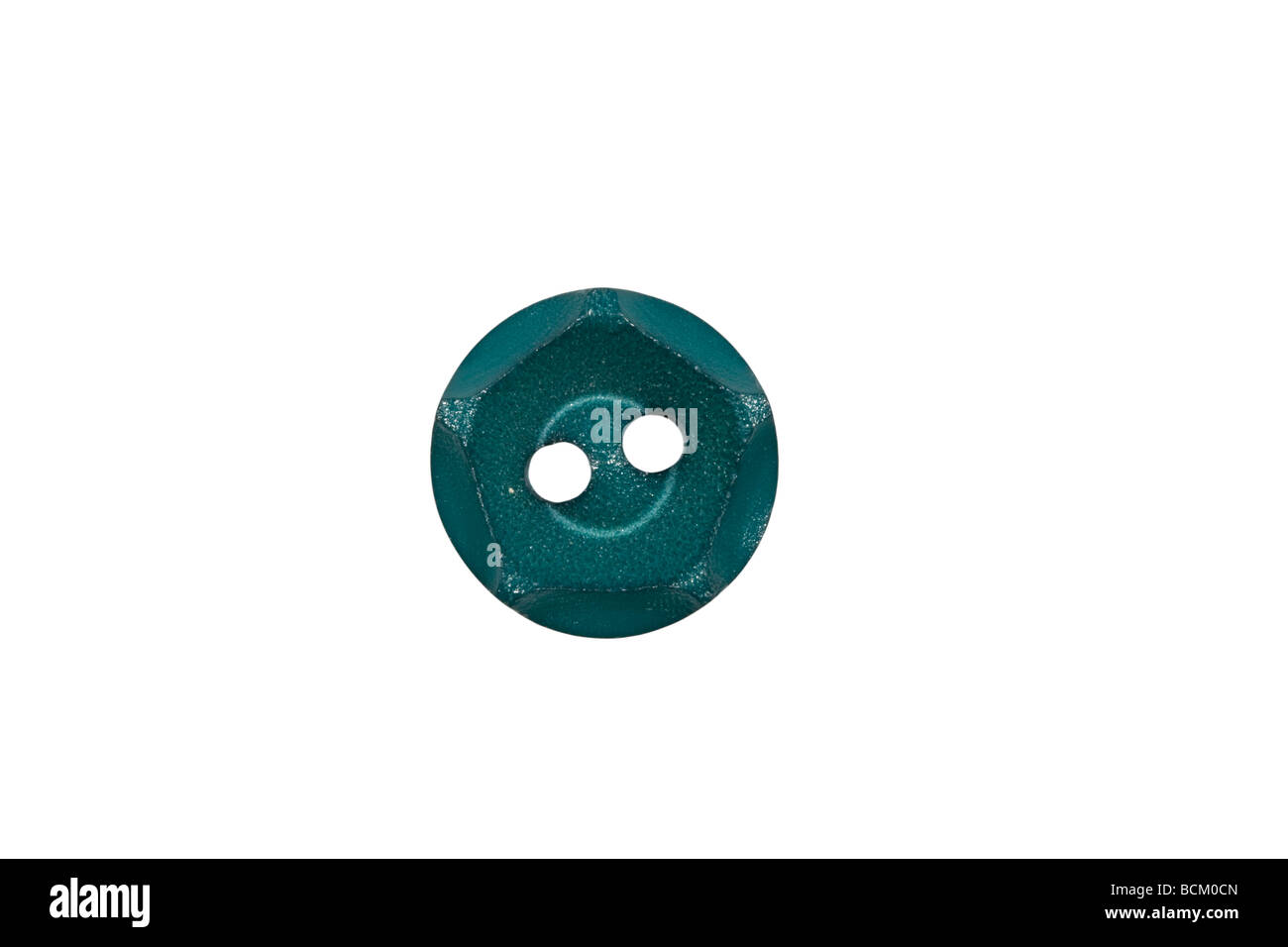 Turquoise coloured plastic button - Stock Image