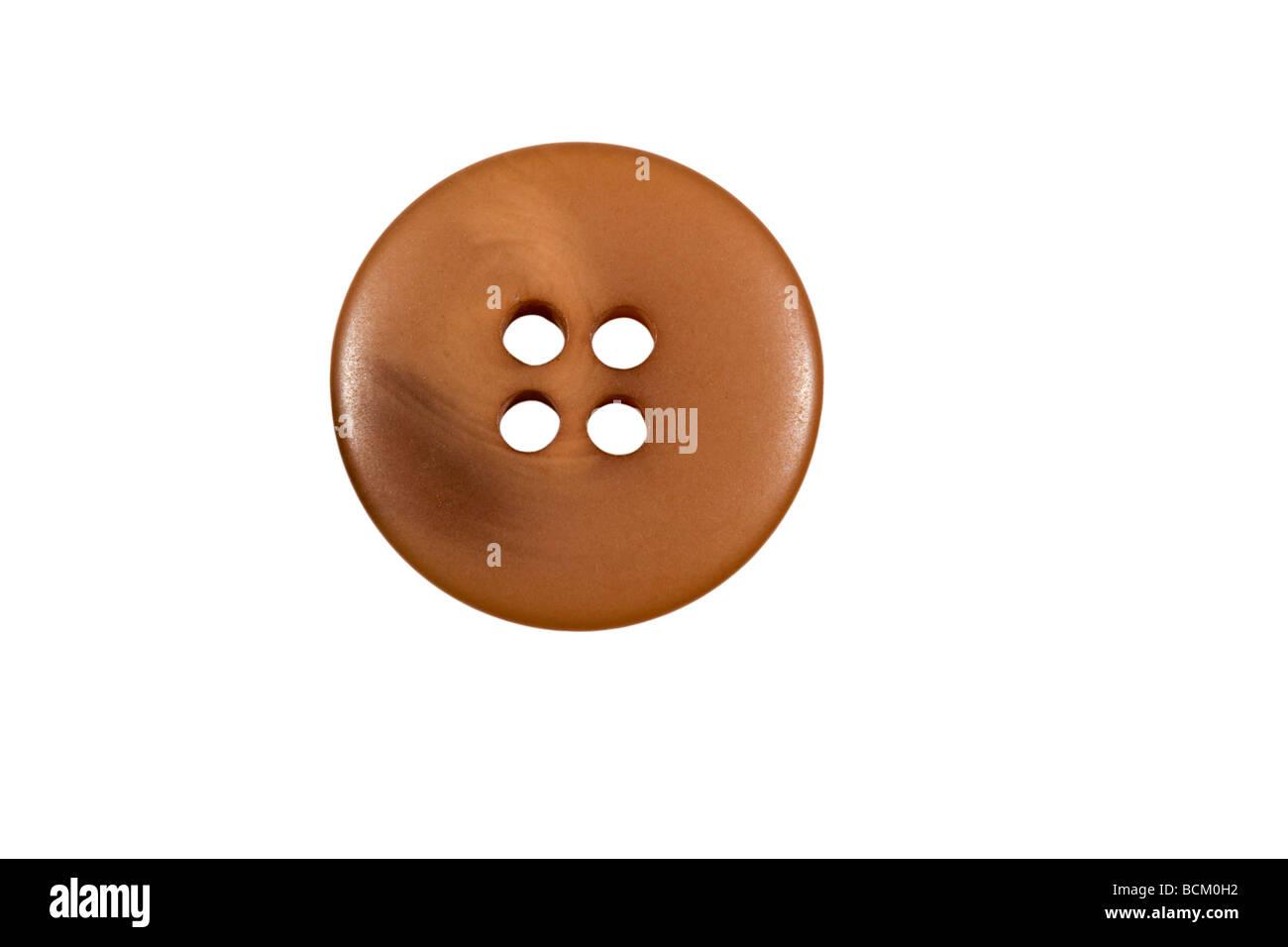Reddish brown coloured button - Stock Image