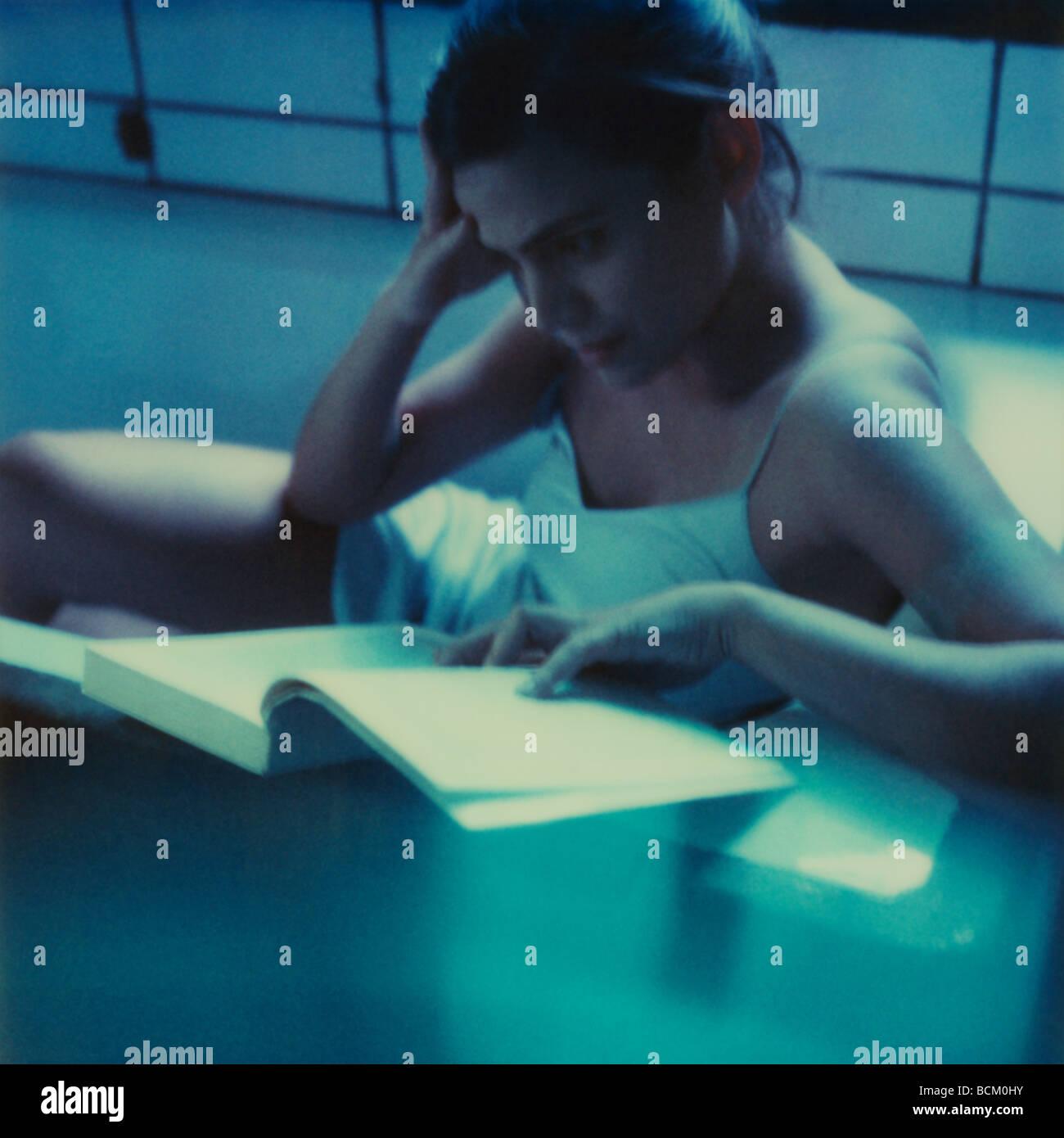 Woman sitting in bathtub, reading Stock Photo: 25025783 - Alamy