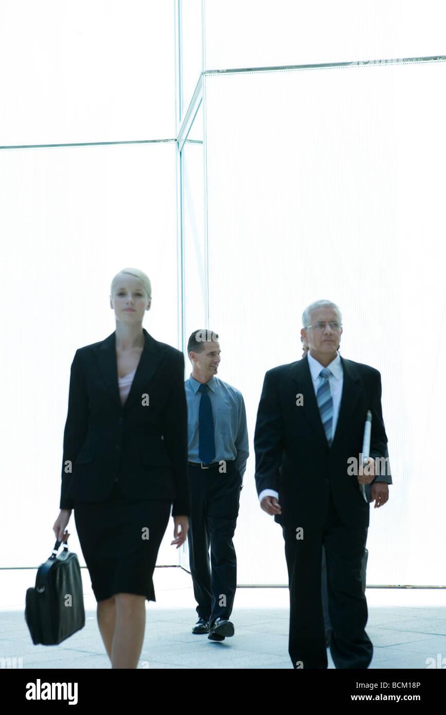 Business people walking toward camera - Stock Image