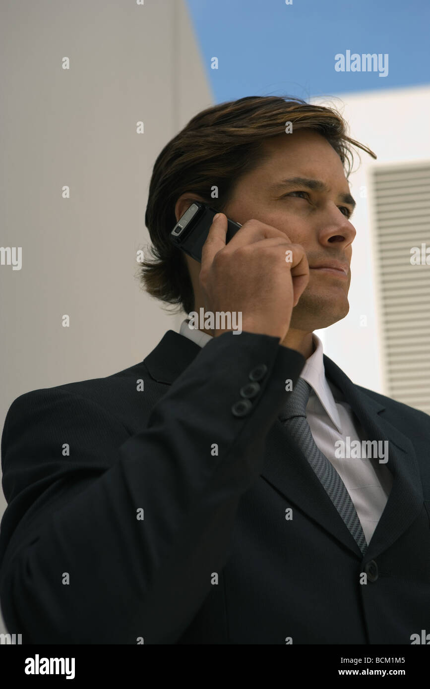 Close-up of businessman using cell phone - Stock Image
