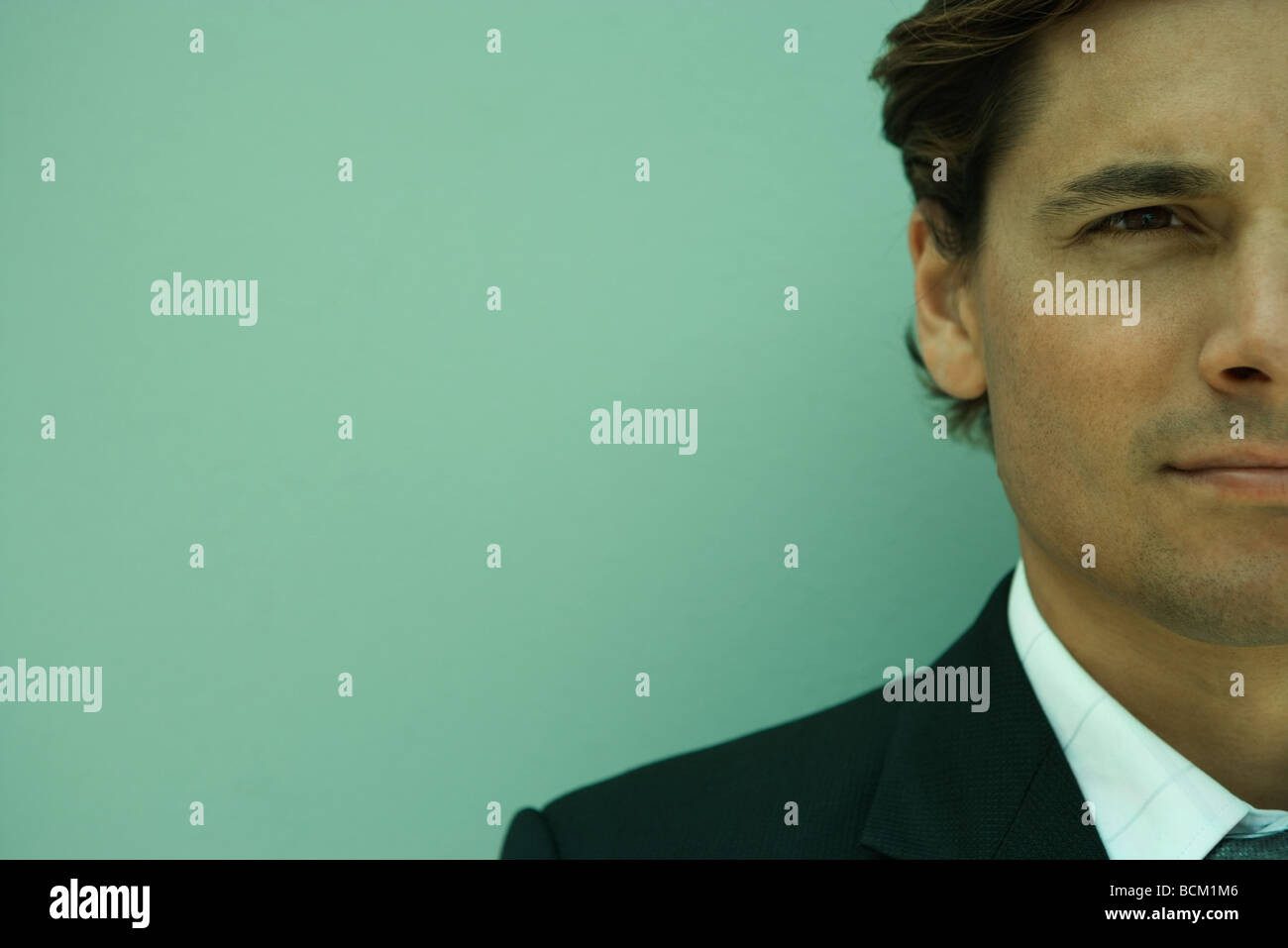 Close-up of businessman, portrait, cropped - Stock Image