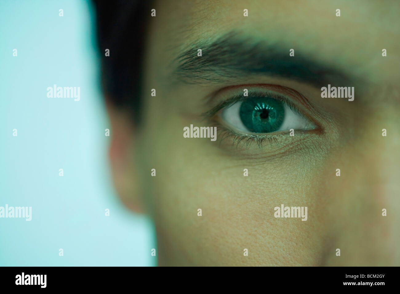 Man looking at camera, close-up of eye - Stock Image