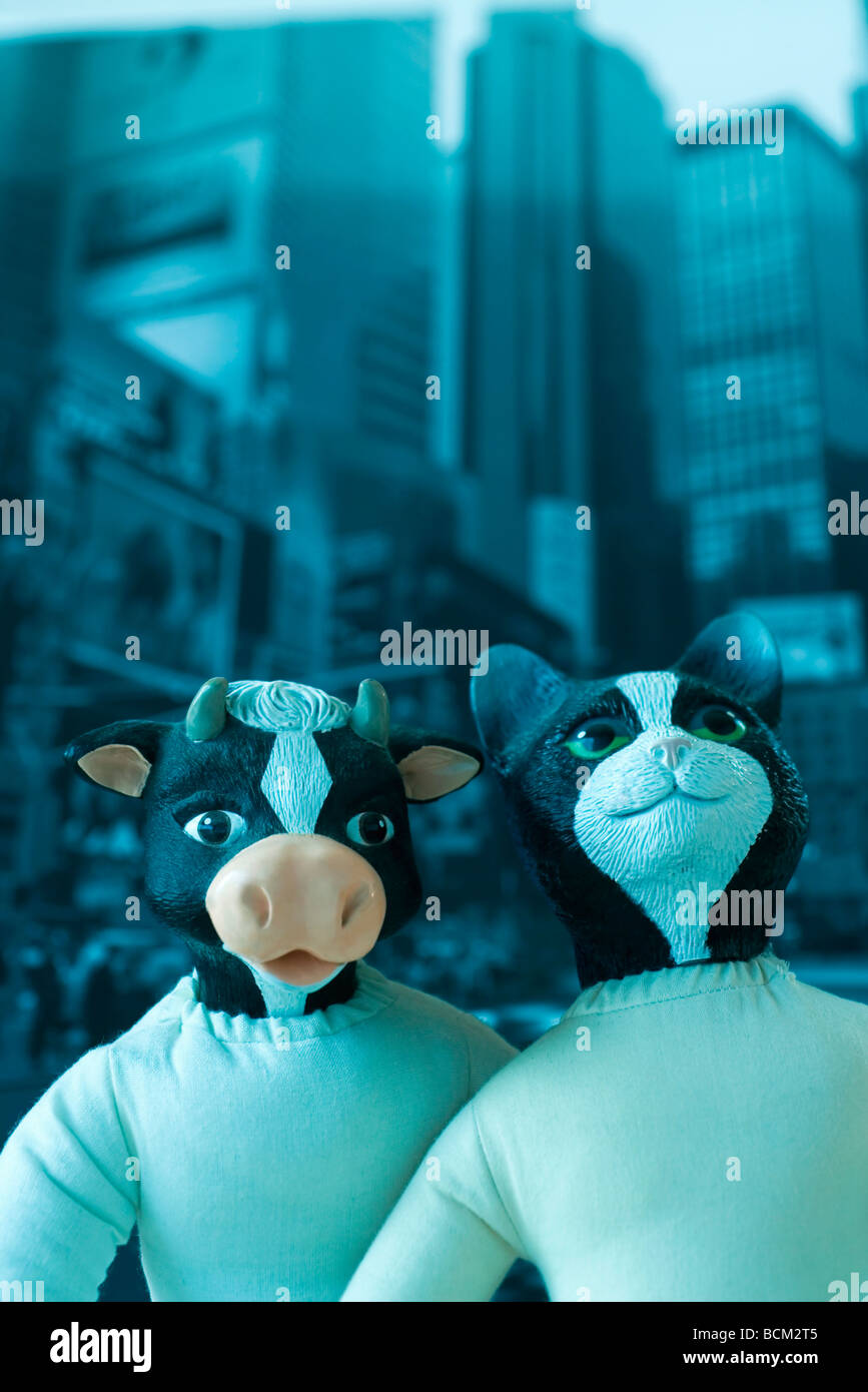 Animal dolls posed in front of city scene - Stock Image