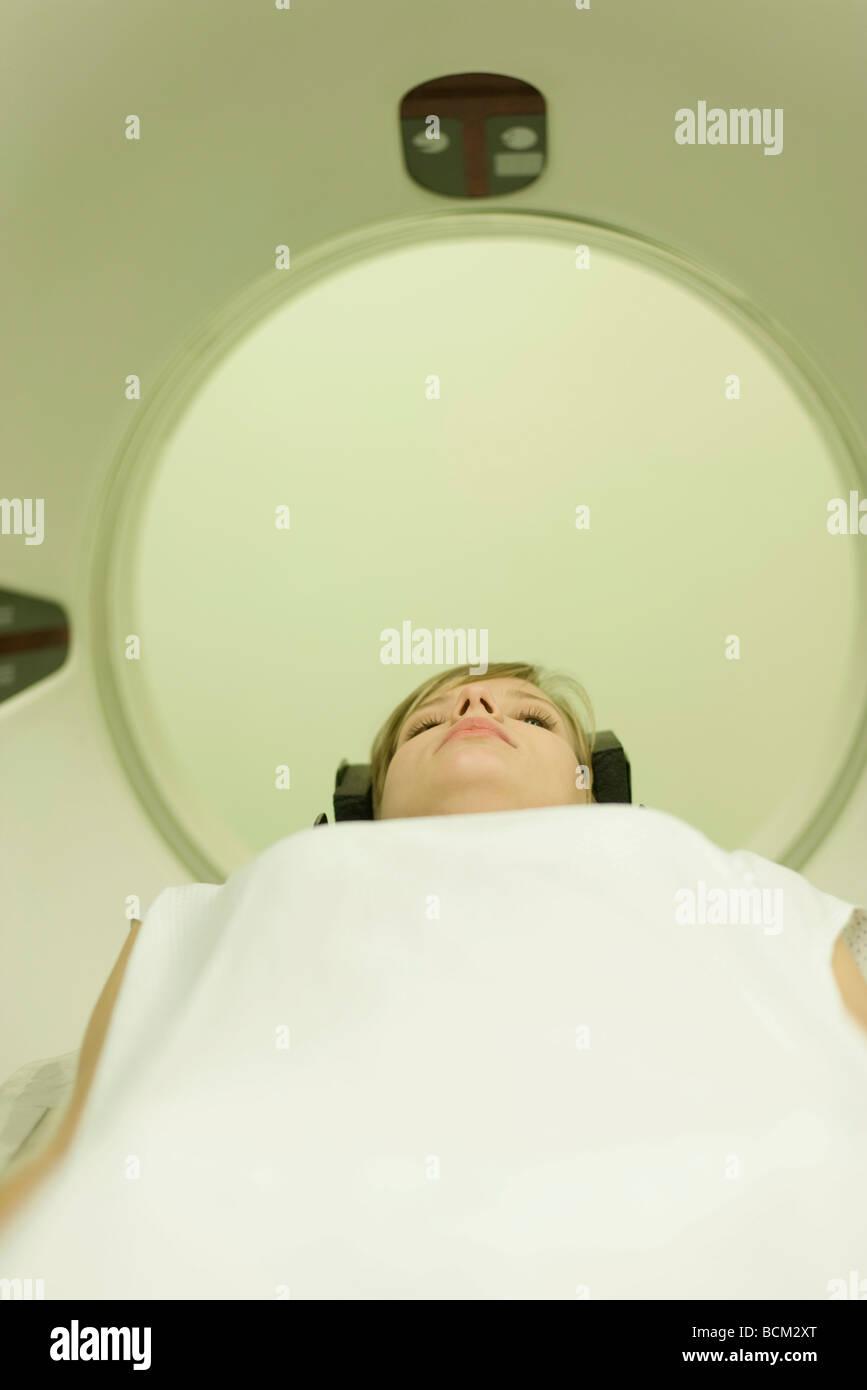 Female patient entering MRI scanner - Stock Image