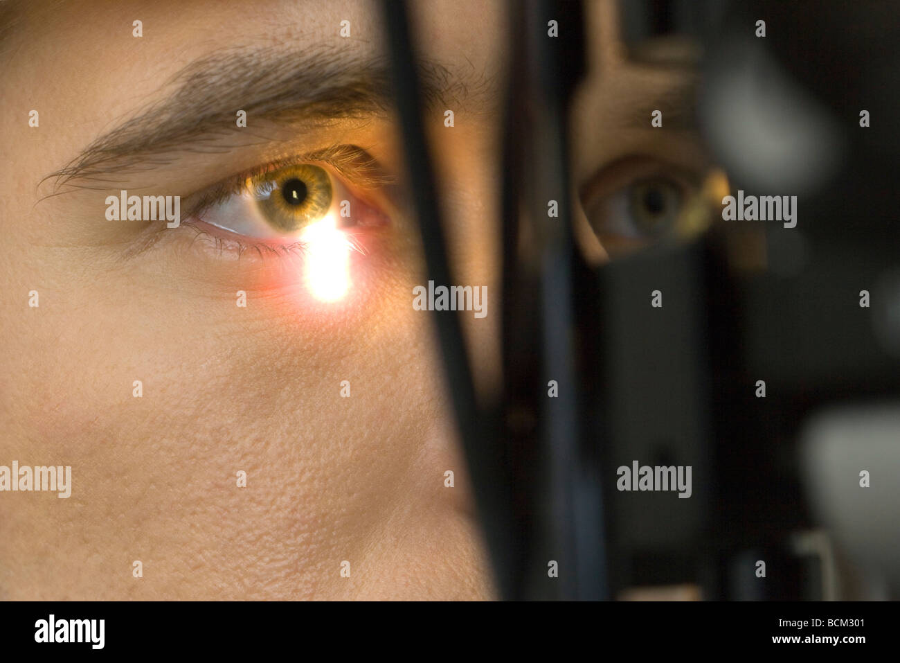Male patient undergoing eye exam, extreme close-up - Stock Image