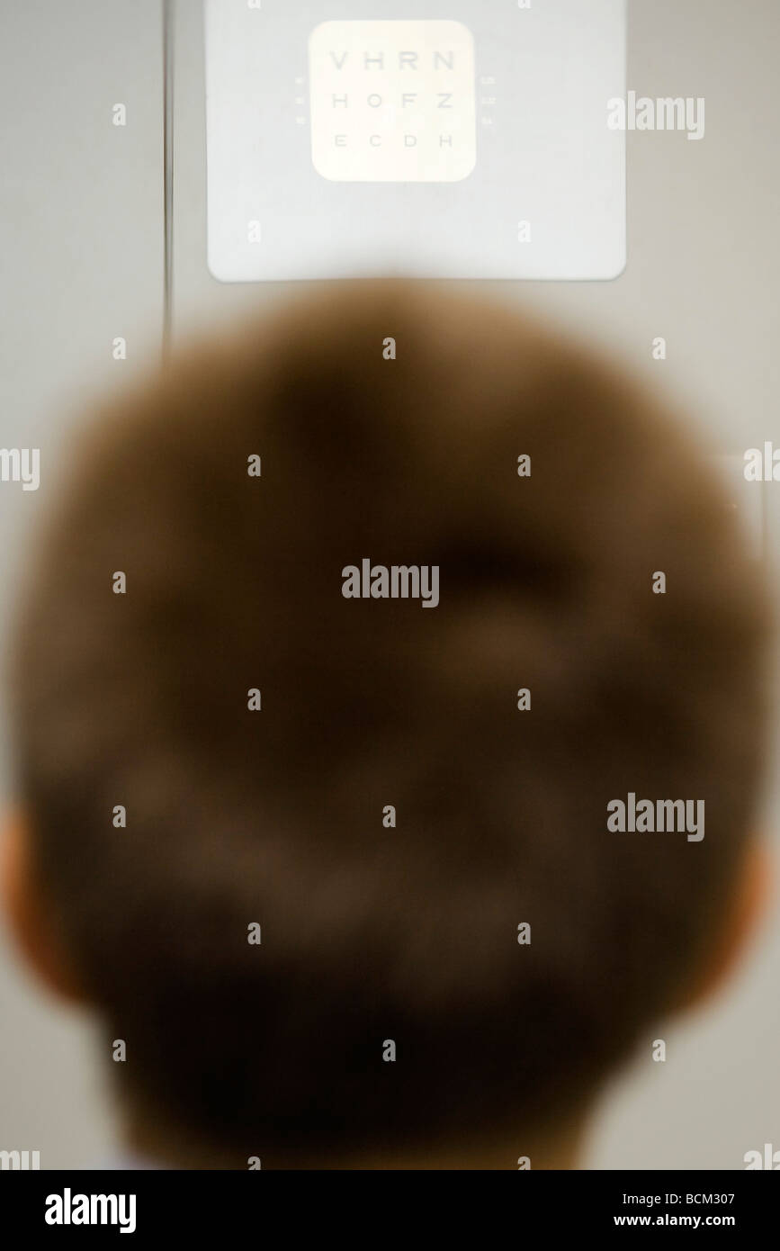 Person looking at eye chart, rear view - Stock Image
