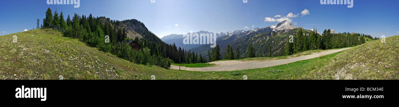Mountain landscape, house visible in distance - Stock Image