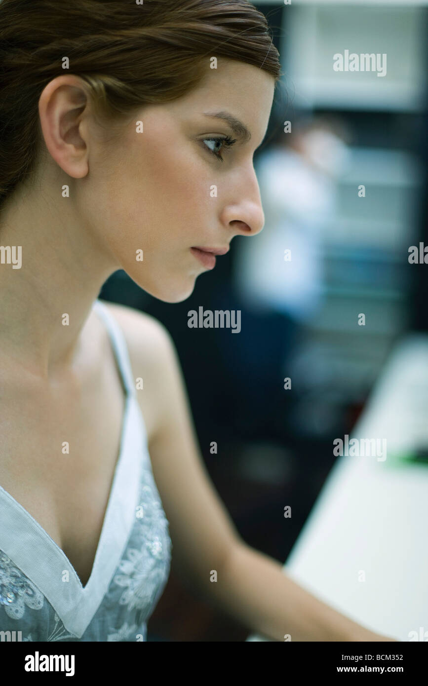 Young woman looking away, profile - Stock Image
