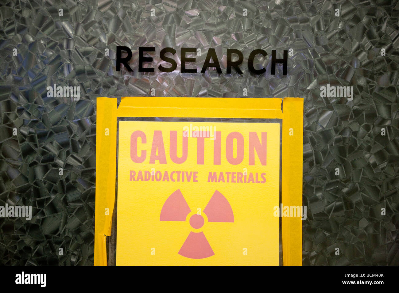 Door into a Research Laboratory with a Caution Radioactive Materials sign - Stock Image