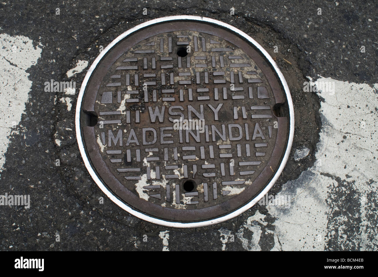 Water pipeline access manhole cover in New York on Saturday July 11 2009 Frances M Roberts - Stock Image