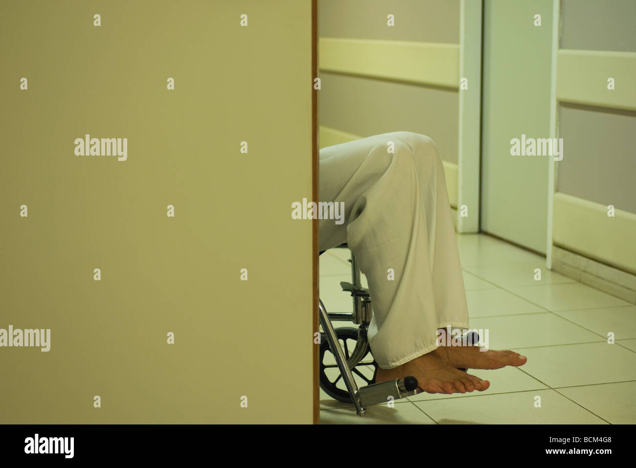 Male patient sitting in wheelchair, cropped view - Stock Image