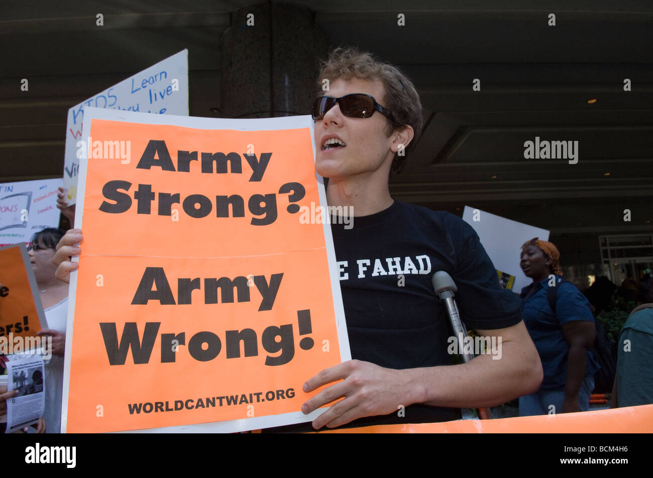 Demonstrators protest the inclusion of Army Strong recruiters outside the NAACP Diversity Job Fair in New York - Stock Image