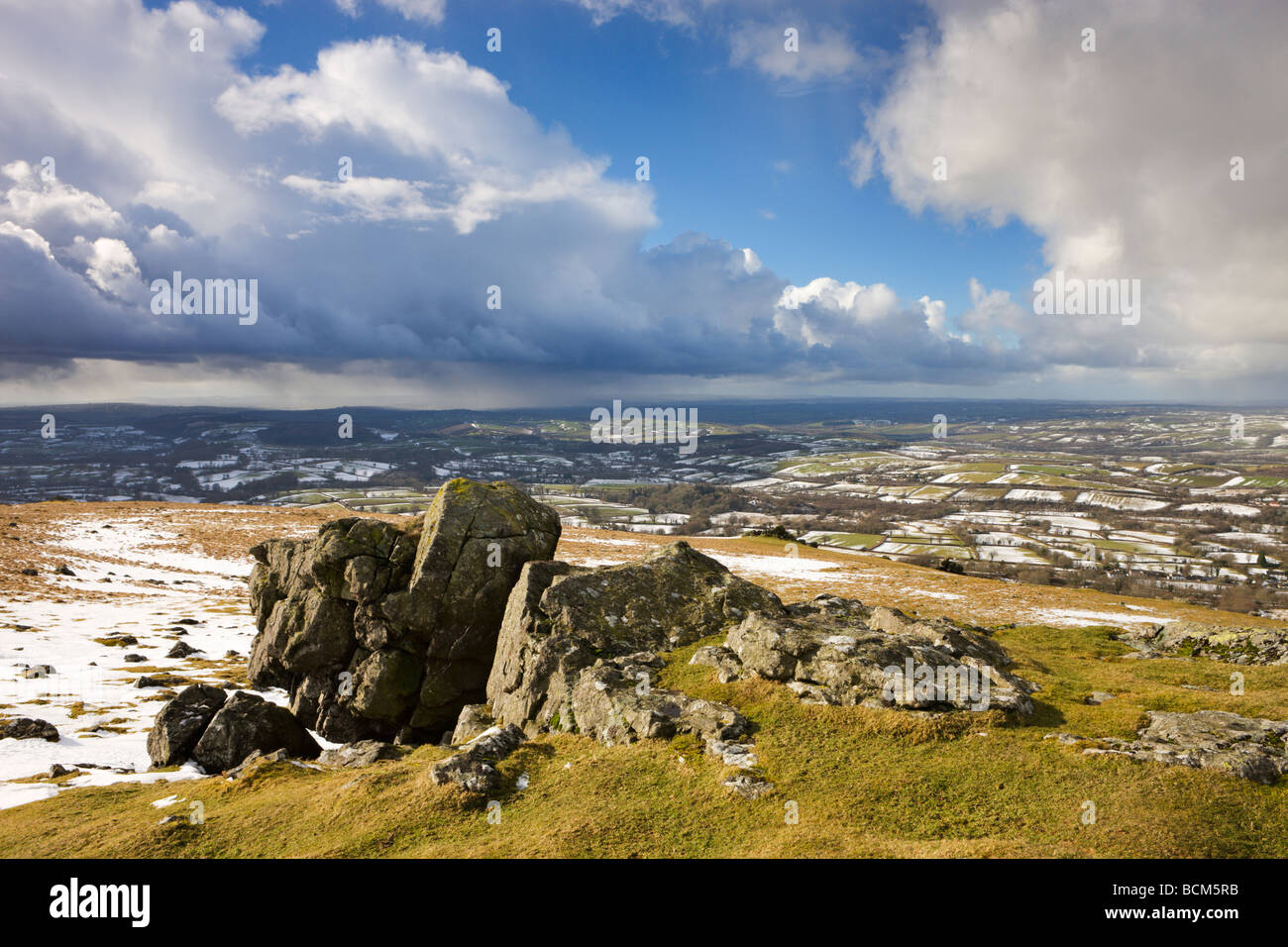 Sourton Tor backed by snow dusted countryside Dartmoor National Park Devon England Winter February 2009 - Stock Image