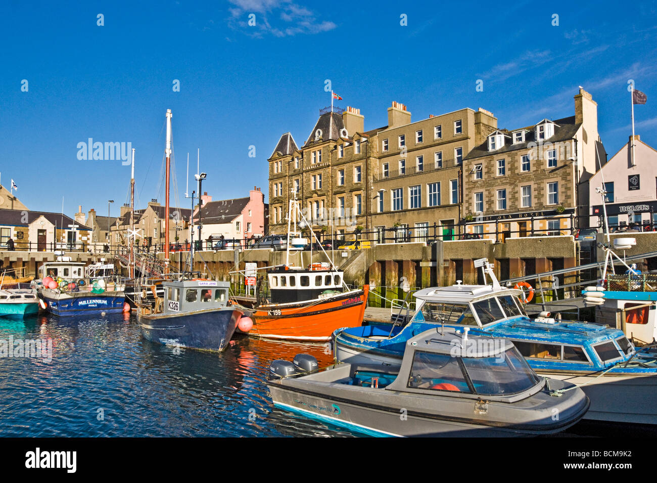 Kirkwall harbour on the mainland of Orkney in Scotland with Kirkwall Hotel centre - Stock Image