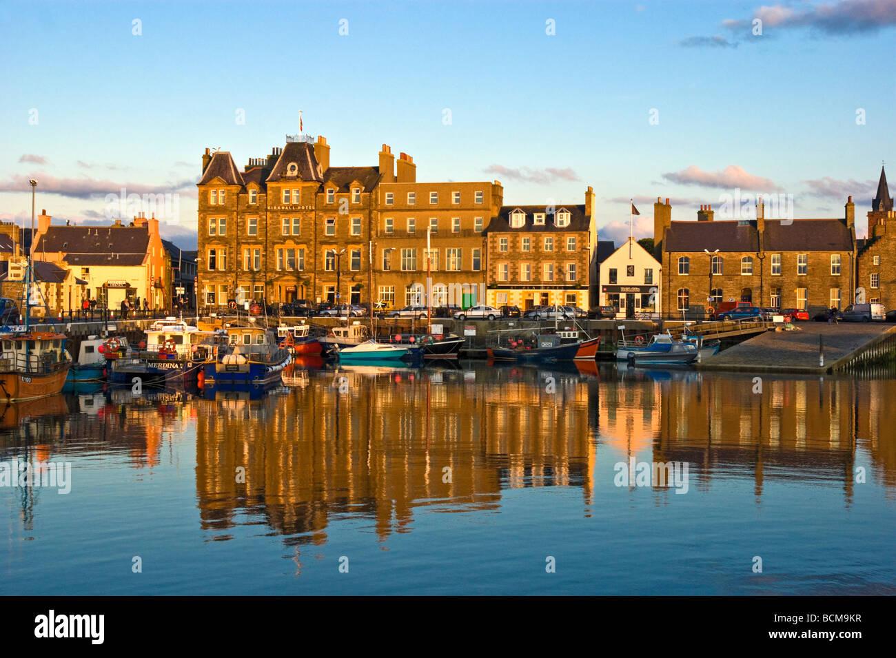 Kirkwall harbour on the mainland of Orkney in Scotland with Kirkwall Hotel left of centre. - Stock Image