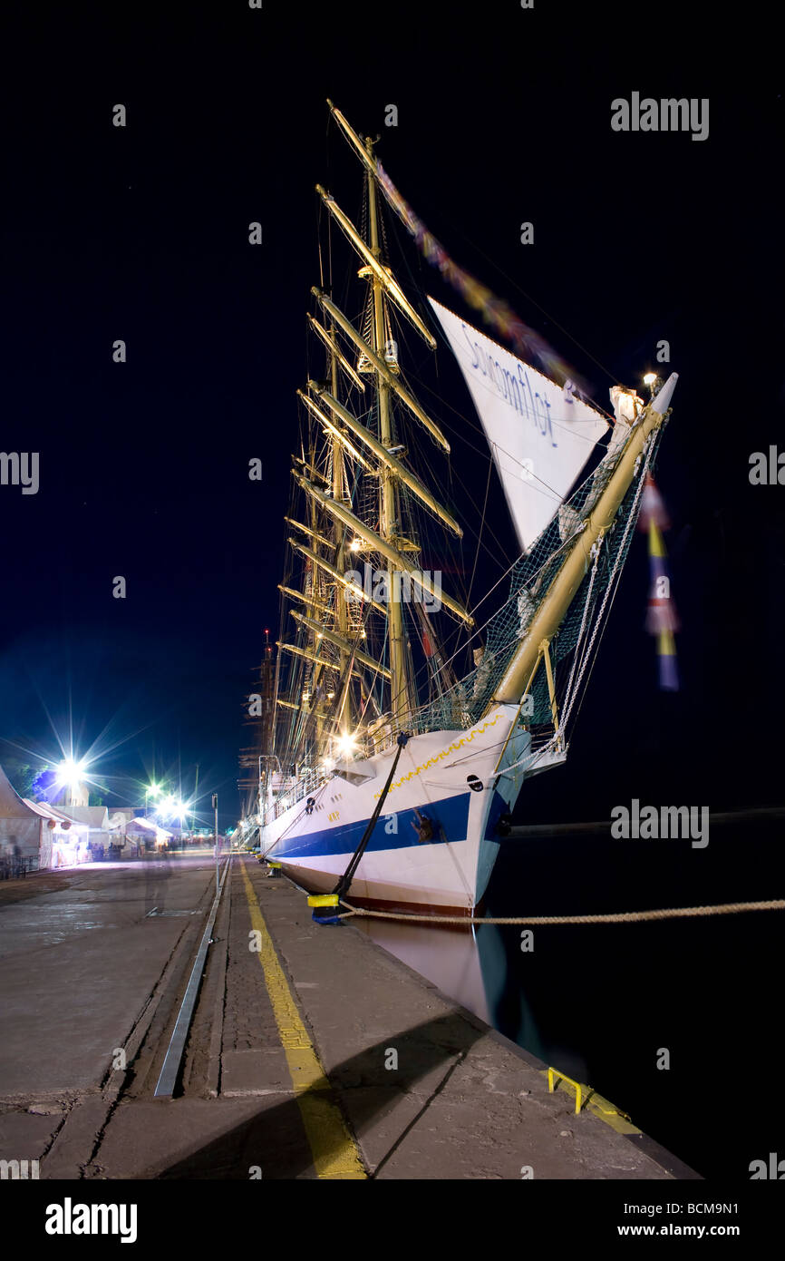 Night shot from the beginning of Tall Ships Races 2009 in Gdynia. One of the biggest and most beautiful ships, Mir. - Stock Image