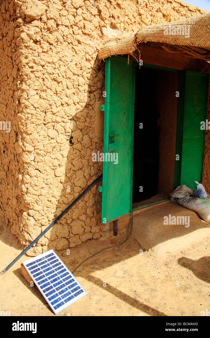 A mud hut in Mali running solar panels as a source of energy - Stock Image