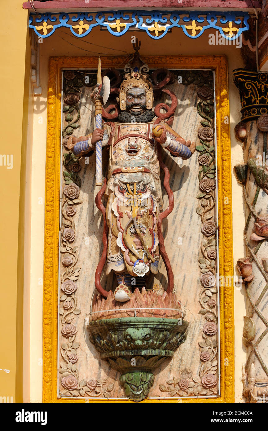 Statue of guardian warrior at the entrance to the Cao Dai temple in Tay Ninh, Vietnam - Stock Image