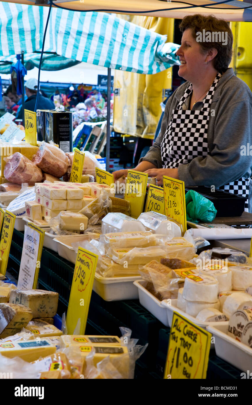 A cheese stall at the Thursday famer s market in the typical English market town of Devizes Wiltshire England UK - Stock Image