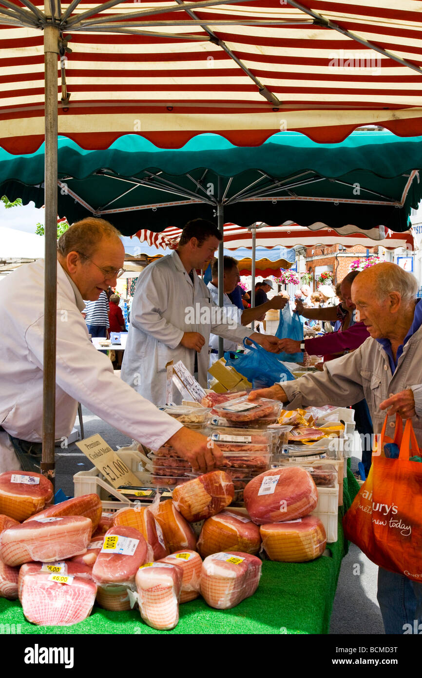 A meat stall at the Thursday famer s market in the typical English market town of Devizes Wiltshire England UK - Stock Image