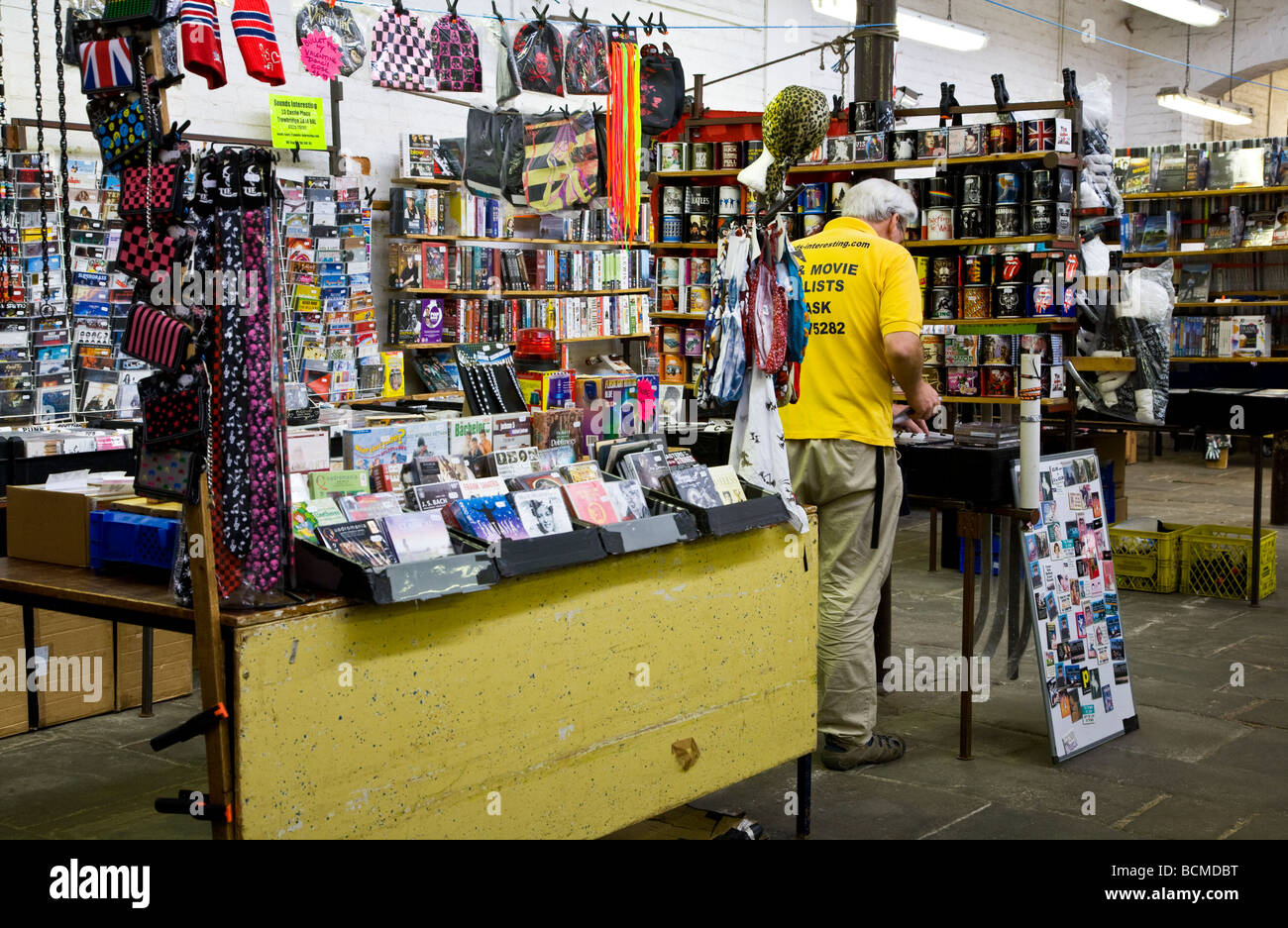 A CD DVD and Video stall at the Shambles Indoor market in the typical English market town of Devizes Wiltshire England - Stock Image
