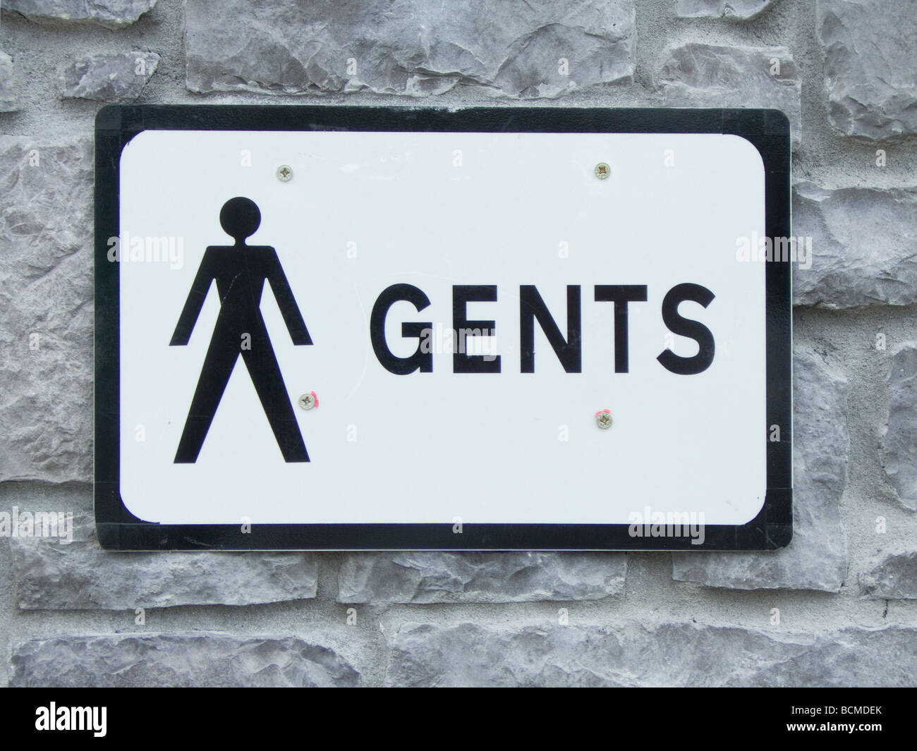 A sign for a mens (gents) public toilet - Stock Image