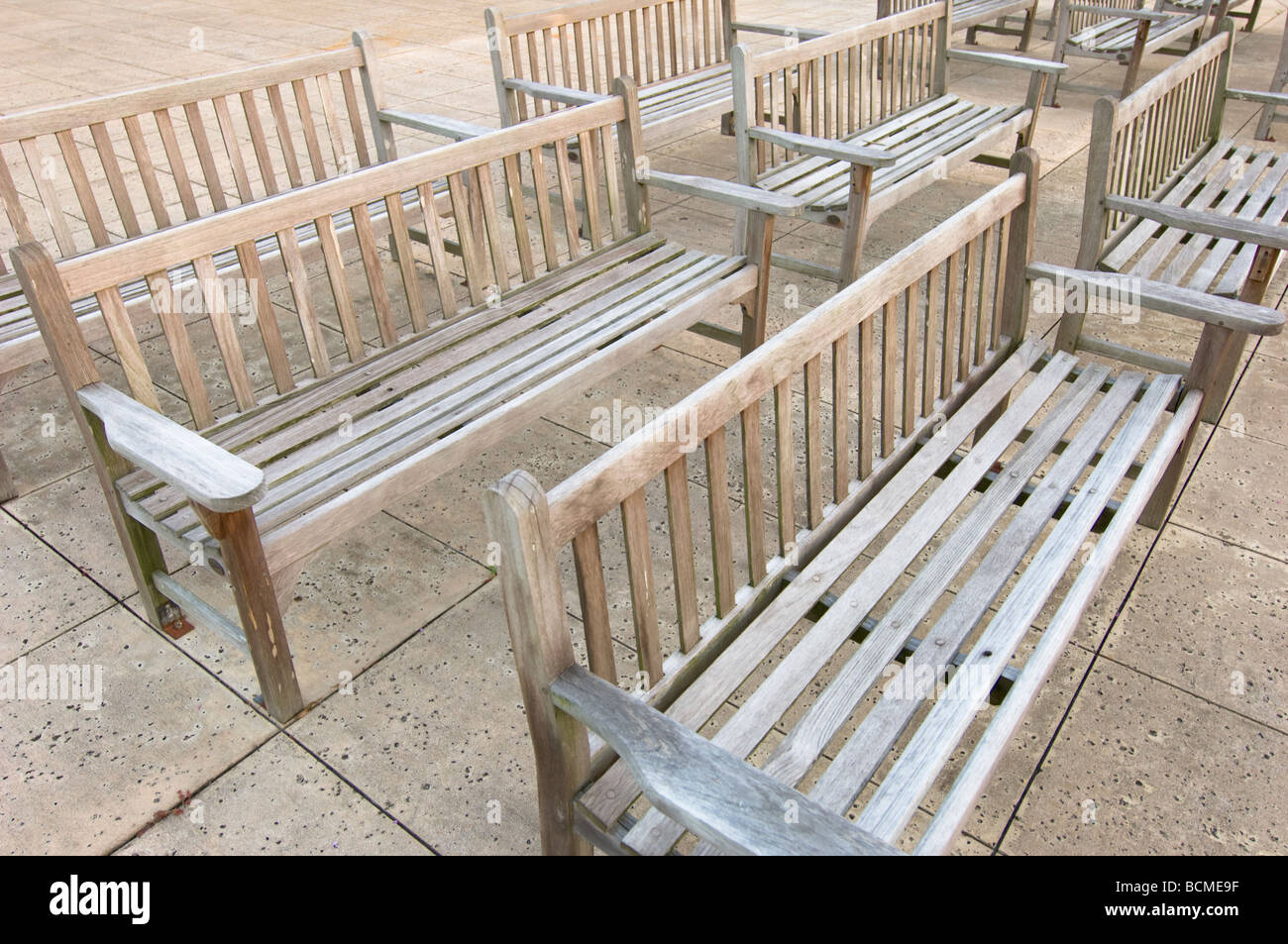 wooden benches weathered outdoors - Stock Image