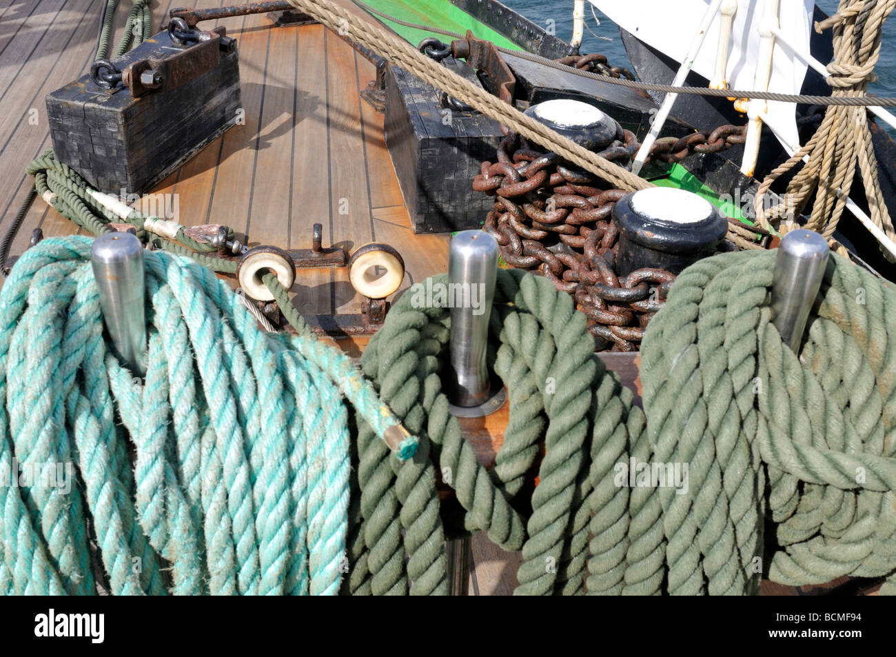 Rope coiled on bitts on deck of  a large sailing vessel tall ship - Stock Image