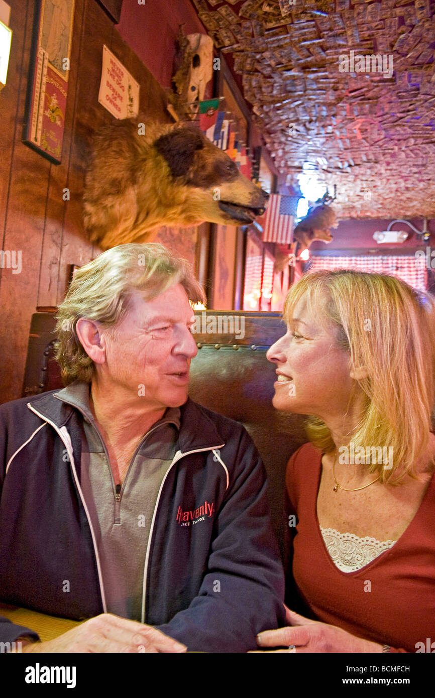 Couple enjoys Shooting Star Saloon in Huntsville, Utah. This is reportedly the oldest continuously running saloon - Stock Image