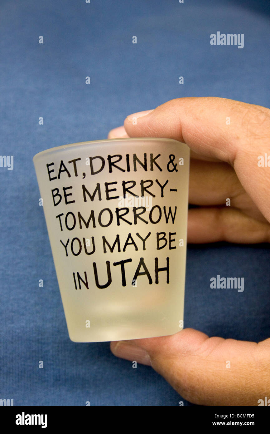 Joke shot glass playing on the conservative views in Utah towards liquor and drinking alcohol - Stock Image