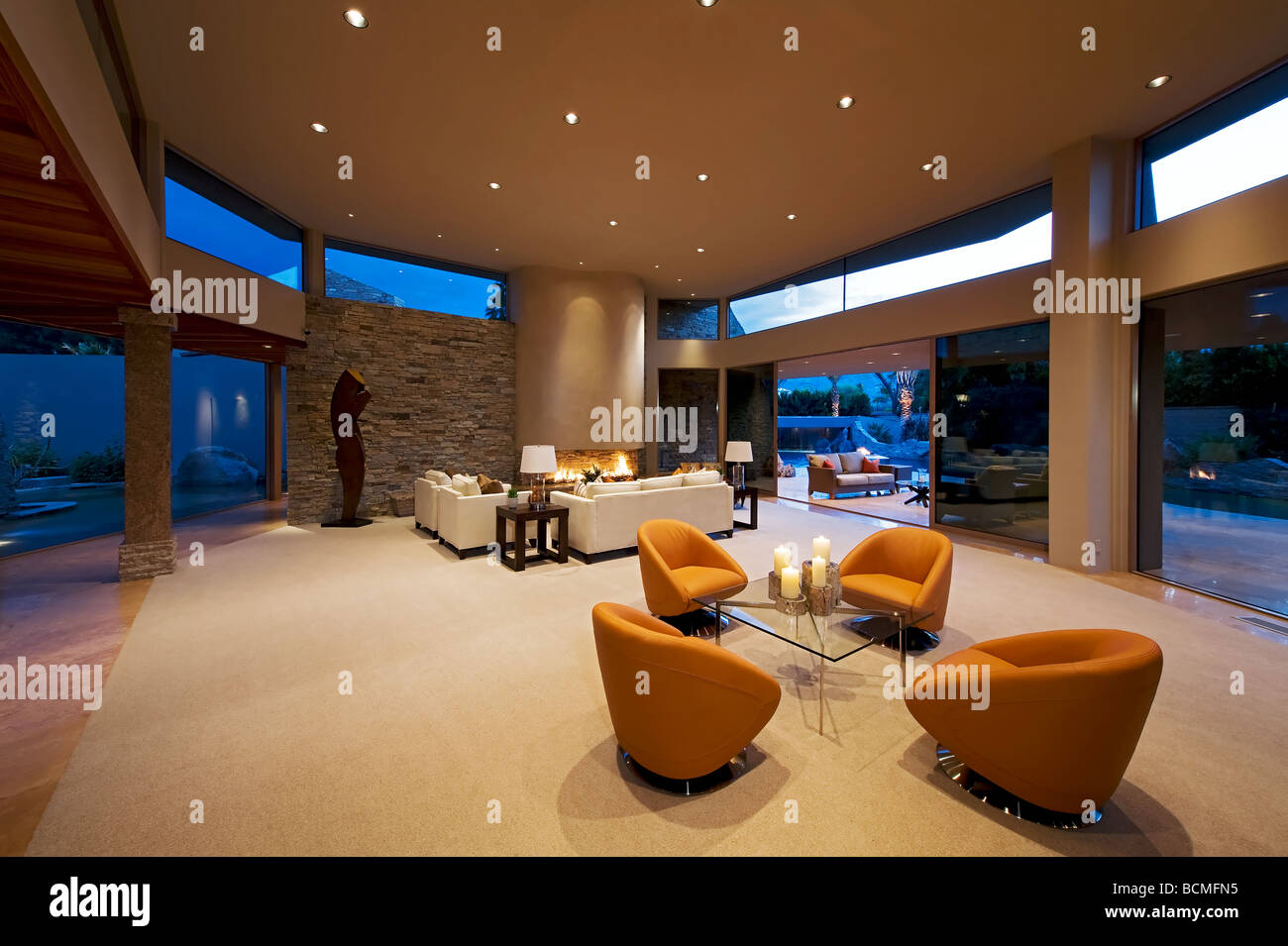 . Ultra modern living room with walls of glass and spars furnishings